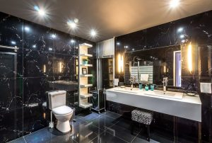 Black bathroom with feature lighting and floating vanity | Maxx Electrical electrician's bathroom renovation guide.